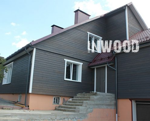 obshivka fasada doma plankenom foto